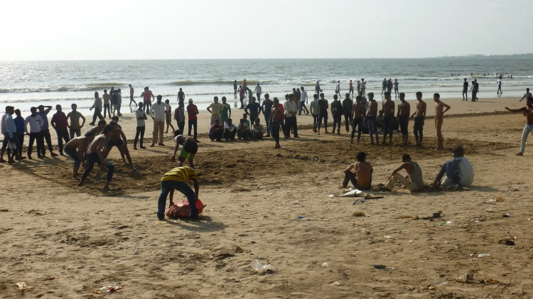Kids playing Kabaddi (an organized version of tag) on the beach