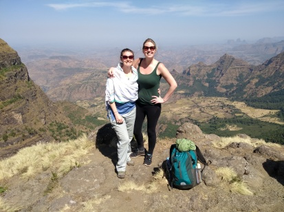 two women posing with simien mountain valley in background